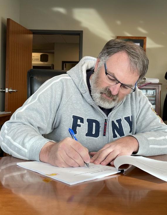 Brent Esplin, Missouri Basin and Arkansas-Rio Grande-Texas Gulf Regional Director, signs the Record of Decision for the ENDAWS project.