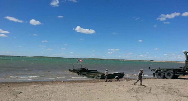 Soldiers from the 200th Engineer Division conducting Dry Span Bridging and Improved Ribbon Bridge training activities on Reclamation lands at Belle Fourche Reservoir as part of the 2017 Golden Coyote Exercise.
