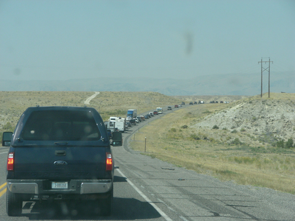 Long line of vehicles leaving Boysen Reservoir following the eclipse.