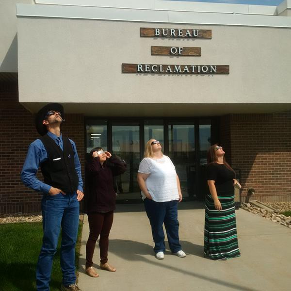 Reclamation employees at the Wyoming Area Office test their solar eclipse glasses.