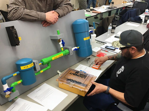 Ronnie Rogers, Flatiron Plant Mechanic, prepares a switching program form and gets ready to apply locks.