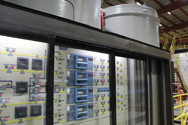 Chemical batching control panel and gravity filter tanks.