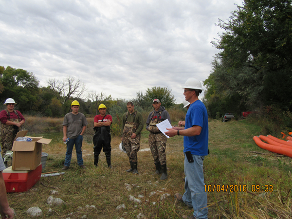 Safety briefing led by Carl Koenig (far right), Reclamation's Maintenance Supervisor.