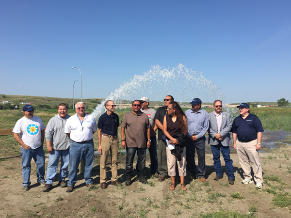 (L to R) Operations Superintendent Standing Rock Water Tom Ridley, Steve Willard, DKAO Project Engineer Tom Thompson, DKAO Area Manager Arden Freitag, Councilman Frank White Bull, Councilman Kory McLaughlin, Councilman Charles Walker, Director Standing Rock Water Randez Bailey, Standing Rock Sioux Tribe Chairman Dave Archambault, South Dakota Governor Daugaard's Representative Steve Emery, Bartlett and West Senior Project Manager Doug Mund.