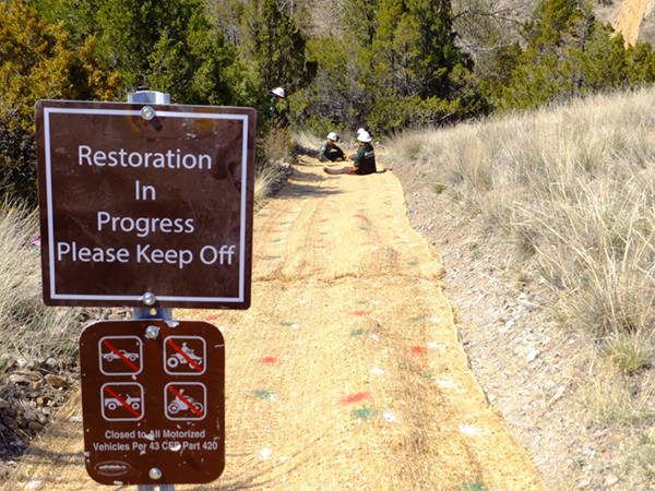 Signs are used to inform the public that restoration efforts are taking place.