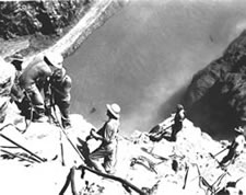 Photo. Surveyors on the canyon wall.