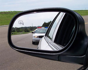 image of a traffic stop in rear view mirror