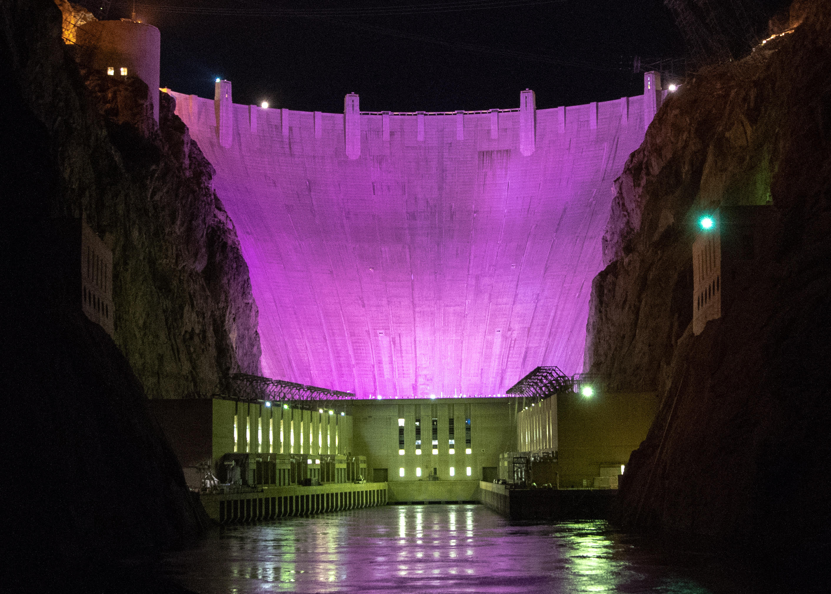 Hoover Dam was lit purple Monday night to raise awareness about the impacts of domestic violence.
