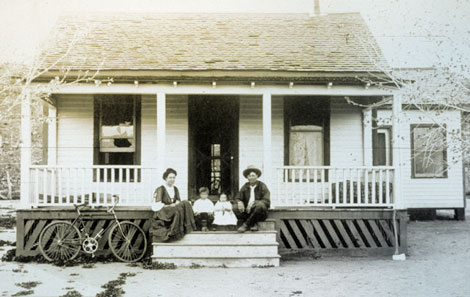 Luther Jackson and his family on the porch of their home, probably at Roosevelt. Luther was a ditch rider, most likely on the diversion canal that brought water to the generating plant.  He was responsible for seeing that the canal worked as planned and was properly maintained, 1909. (Reclamation photograph)