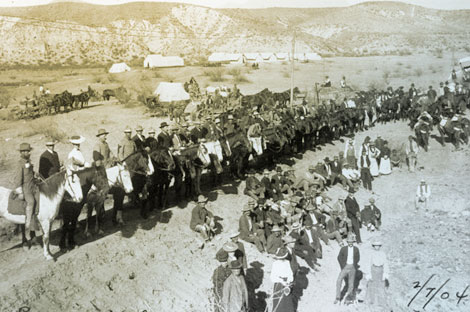 This 1904 photograph shows the dam builders assembled for a special event.  The supervisors and engineers are on horseback, while workers and some of their wives sit or stand. (Reclamation photograph)