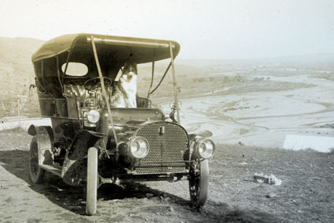 Lubken took this photo of his car and, presumably, his dog in March 1907 somewhere near the town of Roosevelt. The Salt River floodplain is in the background. (Reclamation photograph)
