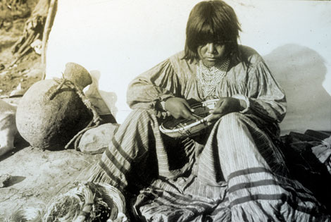 Lubken took a number of photographs of Western Apaches during his time at Roosevelt. Here is an Apache basketmaker, probably at an Apache camp located near the dam construction site.  Apache workmen and their families lived in camps segregated from the other workers. (Reclamation photograph)