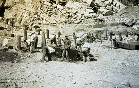 Workers from Arizona Territory—Black, Indian, Mexican, and Anglo—were joined by hundreds of other workers from numerous ethnic backgrounds from across the United States to work on Roosevelt Dam. Here they are pictured excavating the foundation for the dam, 1906. (Reclamation photograph)