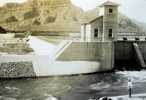 Granite Reef Diversion Dam is located east of Phoenix and diverts water from the Salt River into the Arizona and South canals on the north and south sides of the river, respectively. This 1910 photograph shows the water being diverted into the South Canal. (Reclamation photograph)