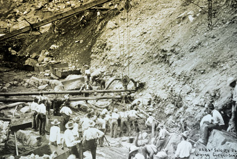 On September 20, 1906 workers ease the cornerstone of the dam into place. (Reclamation photograph)