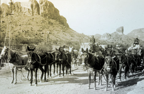Lubken traveled repeatedly on the Mesa-Roosevelt road between the Salt River Valley and the dam site.  At Government Wells where water was available, he captured supply wagons headed to the dam site in December 1907. (Reclamation photograph)