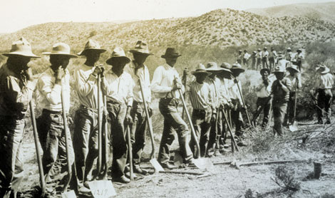 "Apache workers built the road between Mesa and the dam site known as the Mesa–Roosevelt Road, 1907. By the 1920s it was called the  ""Apache Trail."" (Reclamation photograph)"