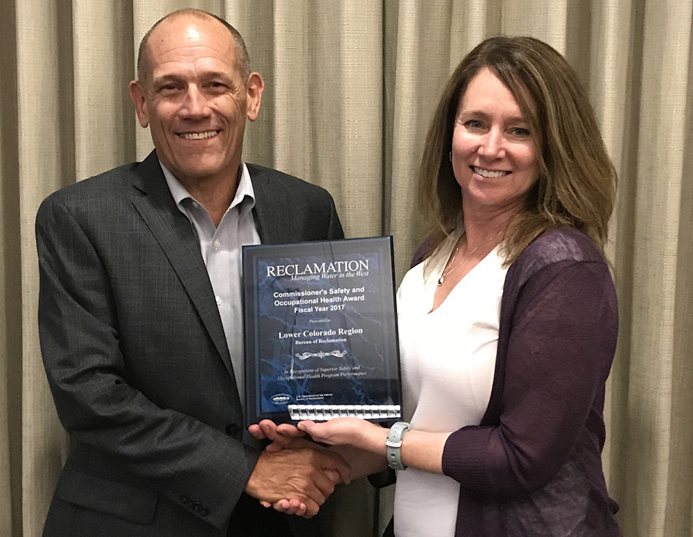 Photo of Commissioner Brenda Burman presenting the Commissioner's Safety Award to Lower Colorado Region Regional Director Terry Fulp.