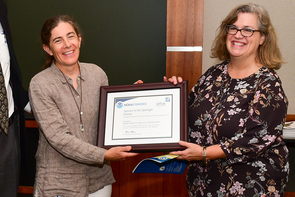 Randi Field (left) accepts National Marine Fisheries Service award in Sacramento Aug. 30, 2019. (USBR photos/Todd Plain)