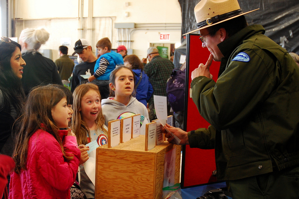 Park Ranger Todd Eggert quizzes children at the California Duck Days event.