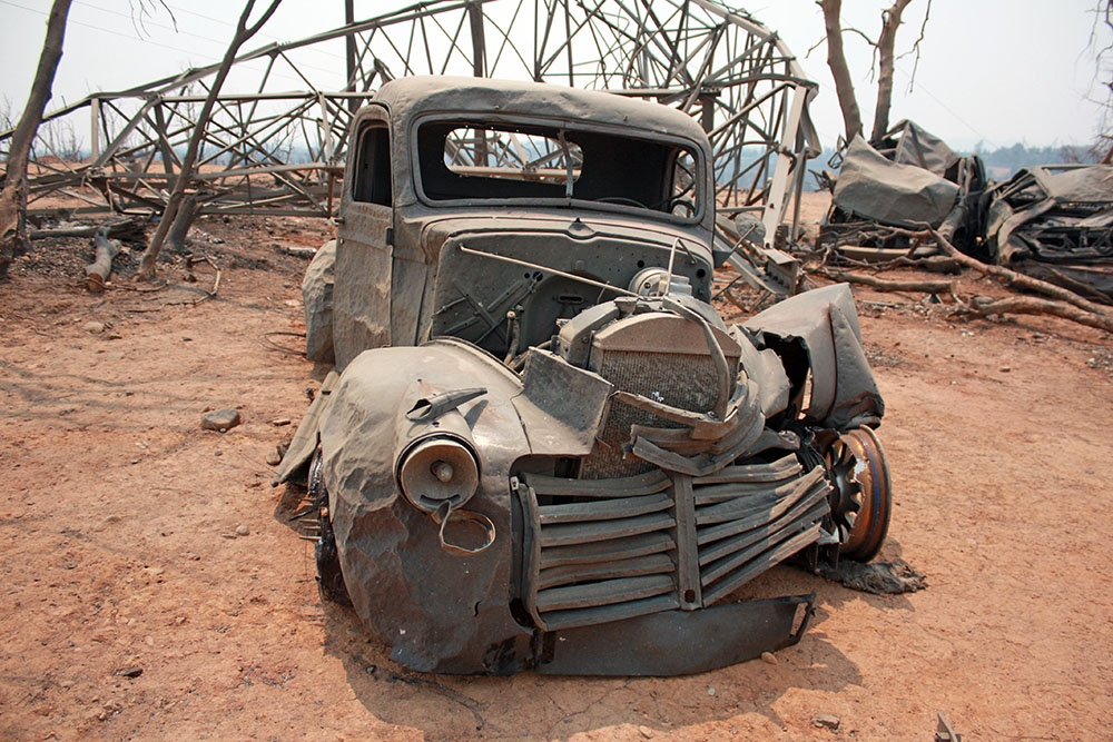 Carr Fire affected vehicle and power-tower near Redding, California