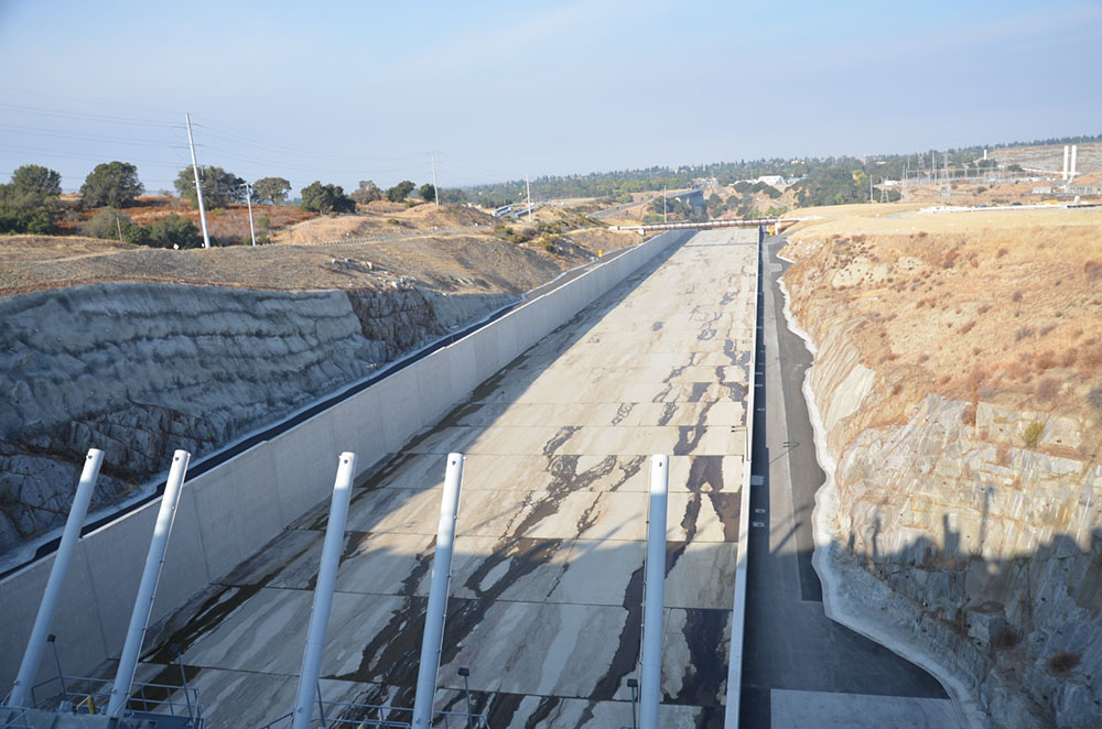 A downstream view from atop the control structure of Folsom Dam's new auxiliary spillway Oct. 17, 2017. (Reclamation photo by Winetta Owens)