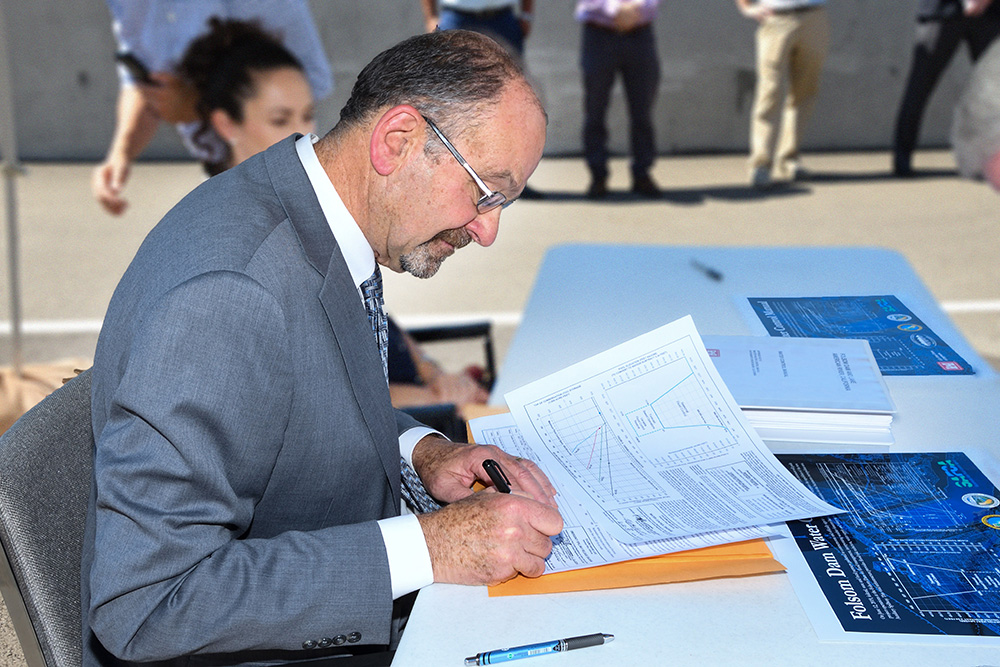 Regional Director Ernest Conant signs Folsom Dam Water Control Manual June 12, 2019. (Reclamation photos by Winetta Owens)