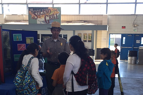Park Ranger Hugo Martinez teaches children about Lake Berryessa at Solano County Fair Association's 15th annual Youth Ag Day.