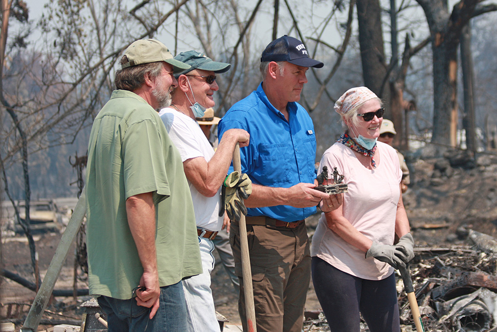 Interior Secretary Ryan Zinke (in blue) with Carr Fire affected residents near Redding, California.