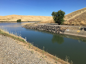 View of water exiting the Tehama Colusa canal and entering Funks Reservoir