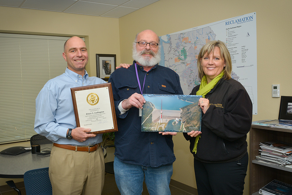 From left to right is Roland Springer, area manager for the Snake River Area Office; Bruce Ludington, award recipient and facility manager at Palisades Dam and Powerplant; and Regional Director Lorri Lee of Pacific Northwest.