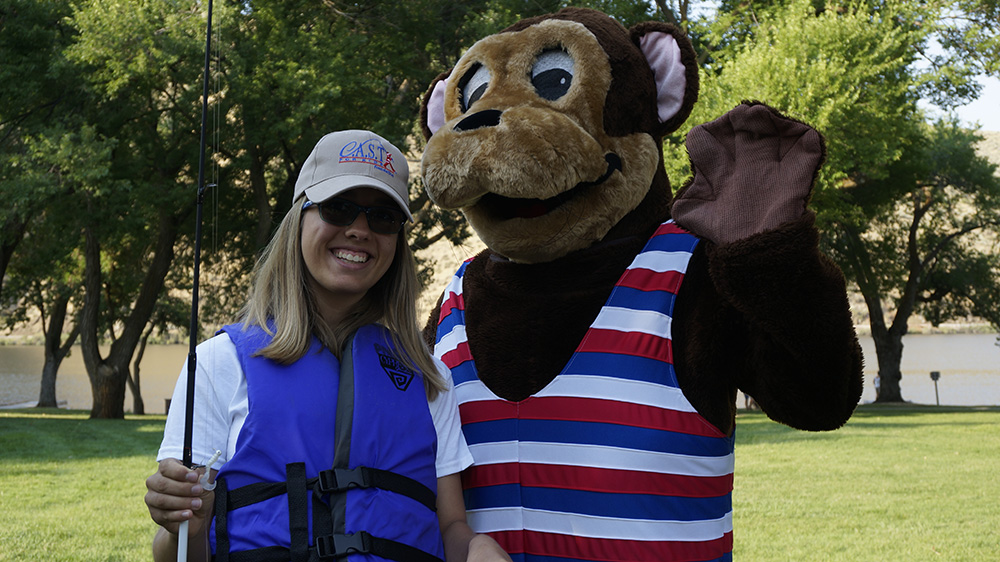 Participant posing with Otto Otter before going out on the lake to fish at the Black Canyon C.A.S.T. event in Emmett, Idaho, August 19.
