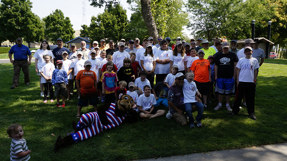 Participants, family members, Otto Otter, and some volunteers pose for a group shot at the Black Canyon C.A.S.T. event in Emmett, Idaho, August 19.