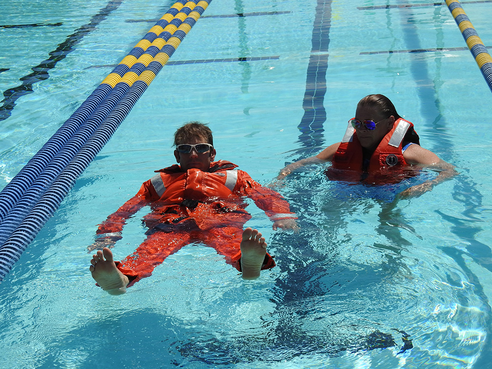 Learning to float in the survival suit.