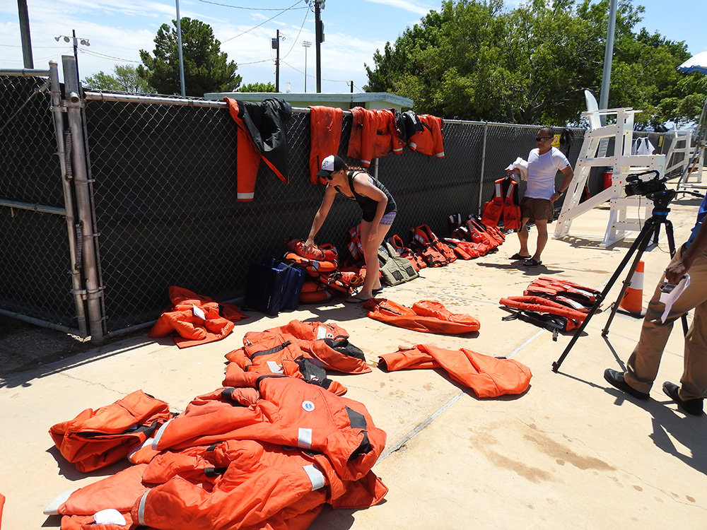 Organizing the various life jackets and flotation devices.