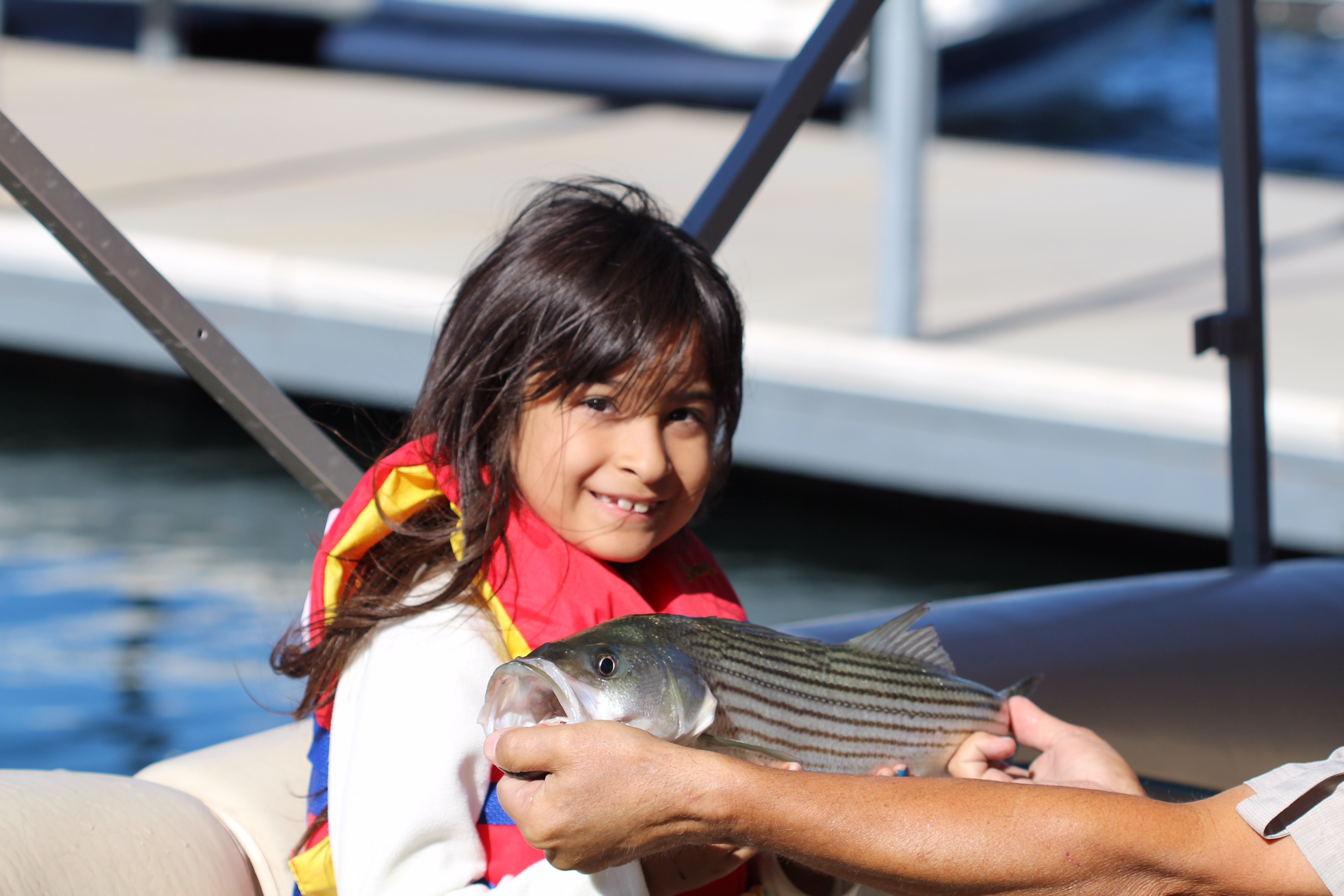A girl with the fish she caught.