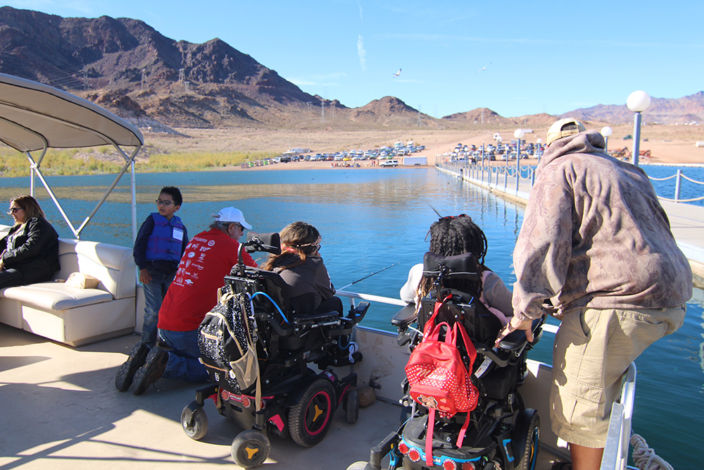 Children fishing from a boat at the C.A.S.T. for Kids event at Lake Mead.