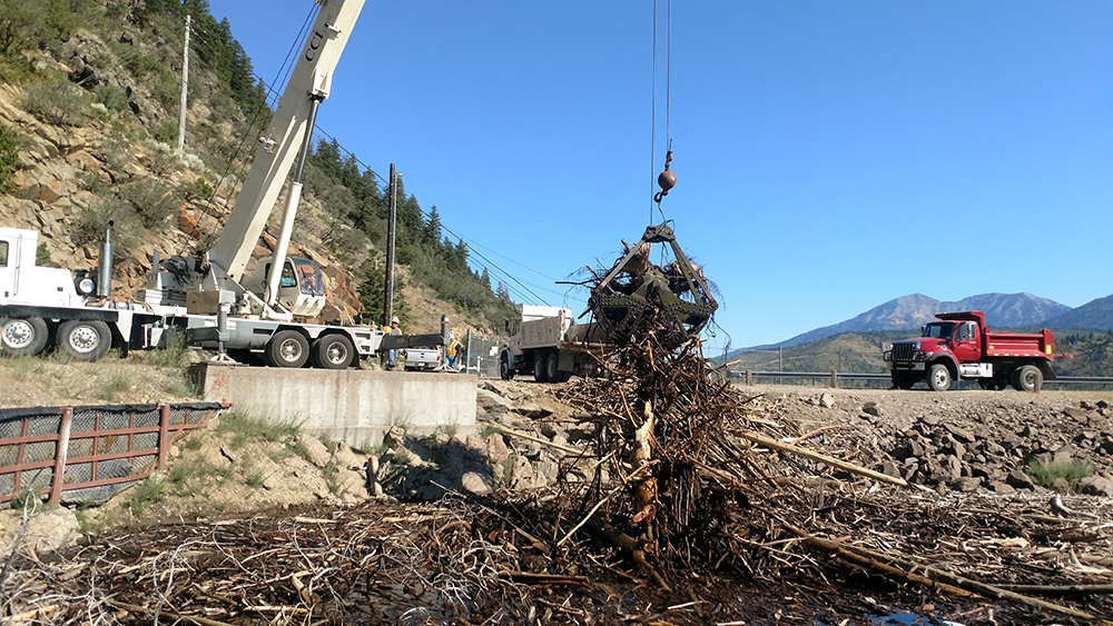 At Palisades Reservoir, CCI Transport and Crane of Idaho Falls, ID removed tons of driftwood  debris from Palisades Reservoir this spring.