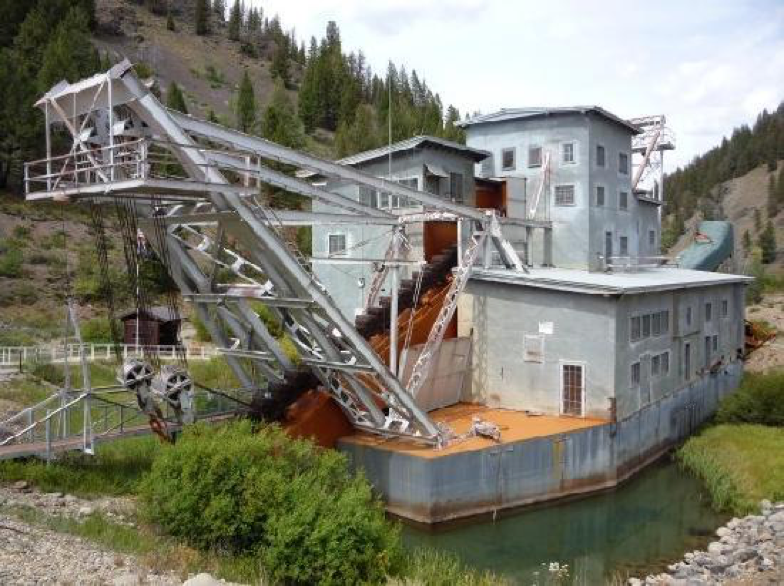 The Yankee Fork Gold Dredge is located in the central mountains of Idaho on the Yankee Fork tributary of the Salmon River. Built in 1940 by the Bucyrus-Erie Company, the dredge ran for 12 years before being buried and abandoned in its current location.