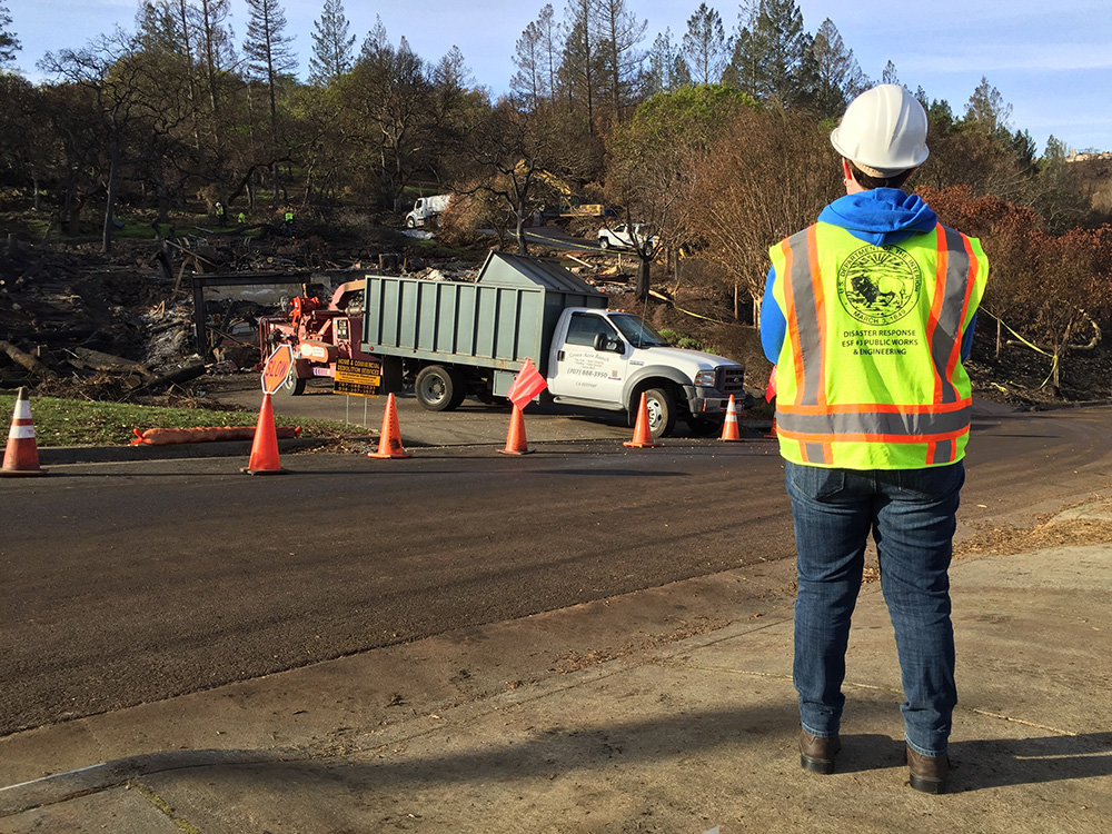 Reclamation volunteer Amy Whittington monitors contract removal of debris materials from destroyed properties in Santa Rosa, California, during cleanup efforts with the U.S. Army Corps of Engineers.