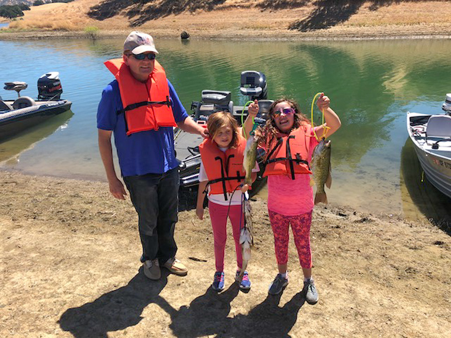 Showing off the catch of the day at the 2018 C.A.S.T. for Kids event at Lake Berryessa in Napa, California.