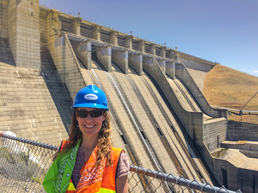 Connie stands in front Folsom Dam