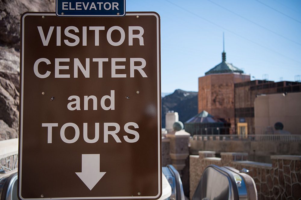 The sign directing people to the Hoover Dam Visitor Center.