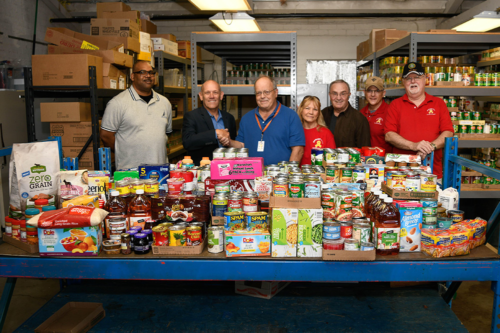Photo: Lower Colorado Regional Director Terry Fulp, second from the left, with some of the food donated to help Emergency Aid of Boulder City.