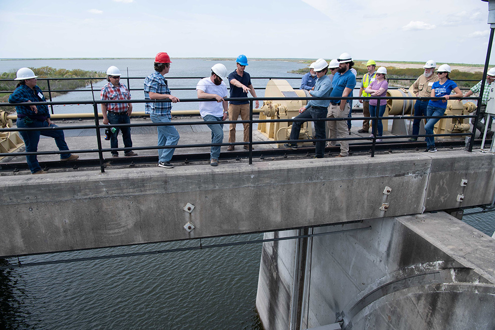 Instructor and students learn how to inspect a dam at Choke Canyon Dam in Texas.
