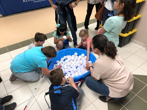 Students from the New Mexico School for the Blind & Visually Impaired learn about the percentage of salty, ice and fresh water on the planet during a modified lesson at the Brackish Groundwater National Desalination Research Facility.