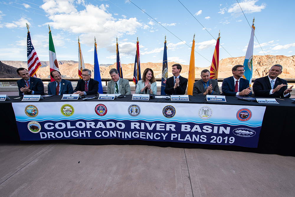 ASWS Petty and Commissioner Burman and principals from each of the Colorado River Basin States signing the DCP at Hoover Dam.