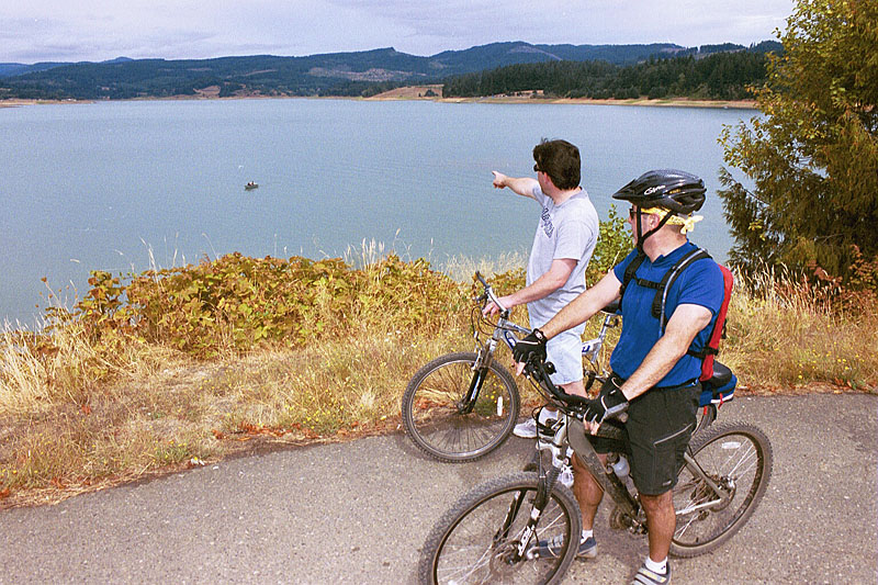 People riding a bike near a Reclamation reservoir. (Photo by Dave Walsh, Reclamation)