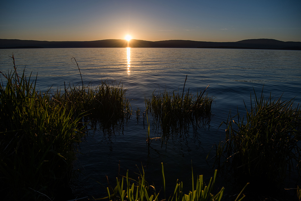 The sun rising over upper Klamath Lake near Klamath Falls, Oregon.