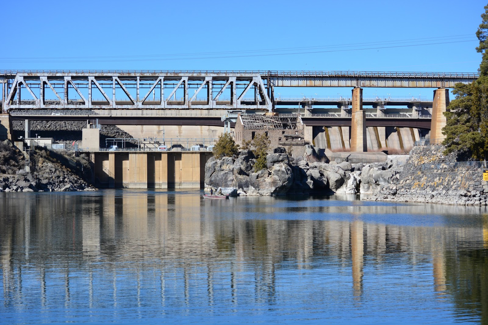 American Falls Dam, Power County, Idaho, viewed from downstream with spillway visible at right below the railroad bridge